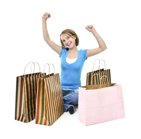 Happy teenage girl with lots of shopping bags photo