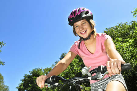 bicycle girl: Portrait of a teenage girl on a bicycle in summer park outdoors