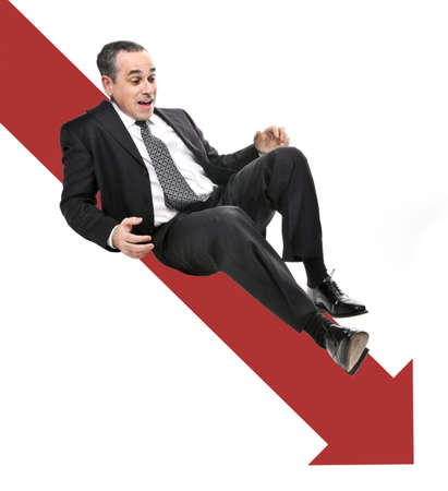 Businessman sliding down red arrow in financial crisis photo