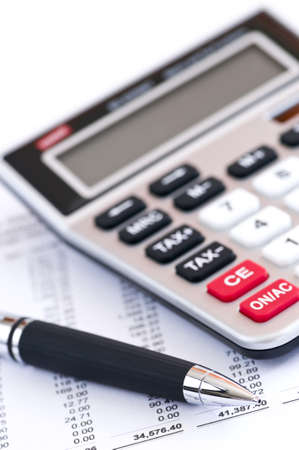 Calculating numbers for income tax return with pen and calculator Stock Photo