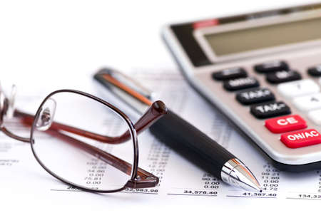 Calculating numbers for income tax return with glasses pen and calculator photo