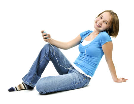 Teenage girl listening to music with her mp3 player photo