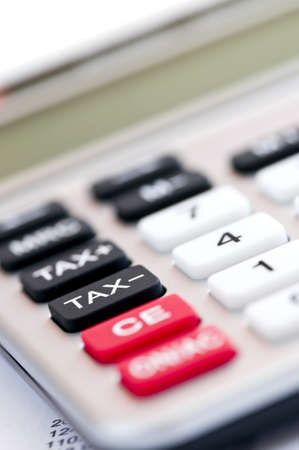 totals: Closeup on tax calculator keypad with red black and white buttons