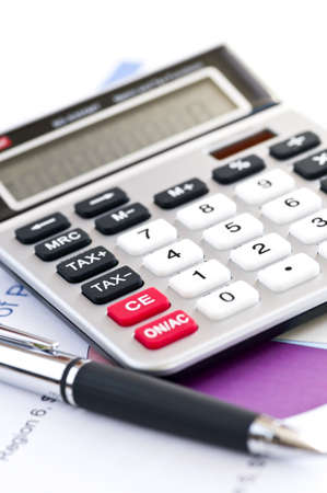 totals: Calculating numbers for income tax return with pen and calculator Stock Photo