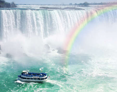 horseshoe falls: Spectacular rainbow near tourist boat at Niagara Falls