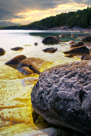 Rocks in clear golden water of Georgian Bay at Bruce peninsula Ontario Canada photo