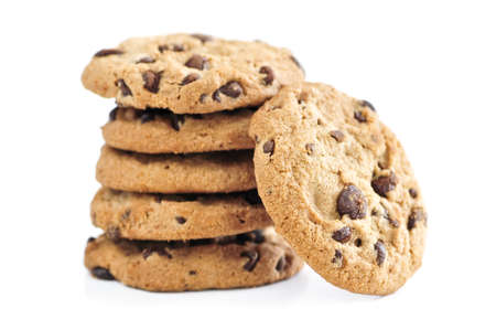 Tall stack of chocolate chip cookies isolated on white background Foto de archivo