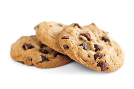 Tall stack of chocolate chip cookies isolated on white background Stock Photo
