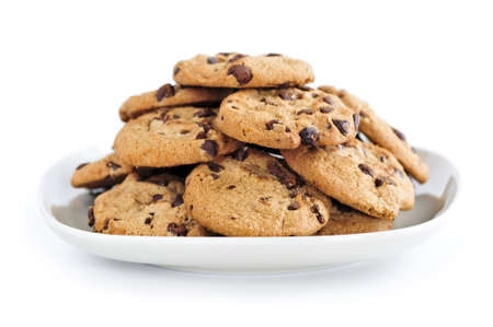 homemade cookies: Plate of chocolate chip cookies isolated on white background