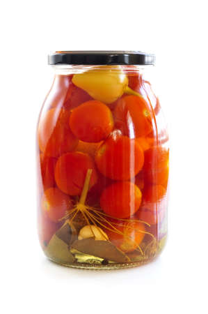 Clear glass jar of colorful pickled vegetables photo