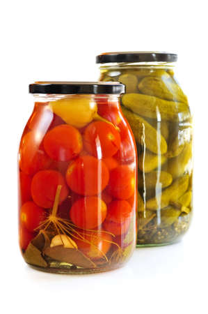 Two clear glass jars of colorful pickled vegetables photo