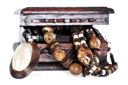 wooden lid: Beautiful handcrafted wooden box with aboriginal jewelry Stock Photo