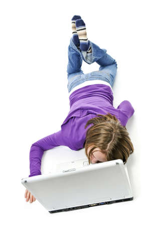 Tired young girl lying down asleep on laptop computer Stock Photo - 4297534