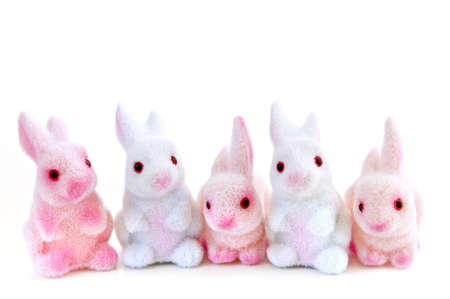 Cute Easter bunny toys isolated on white background photo