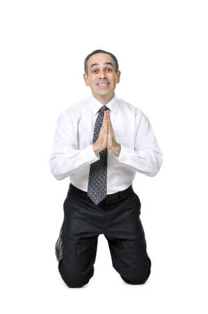 Business man praying in suit isolated on white background photo