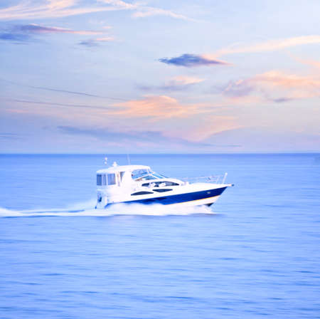 panning shot: Speedboat at dusk, panning shot, in-camera motion blur