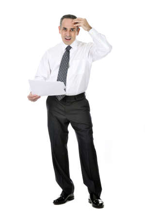 Business man in suit with confused expression holding papers photo