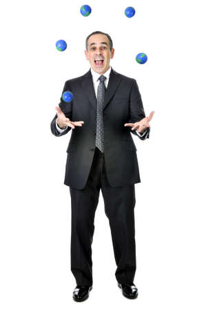 Business man in suit juggling planet earth balls Stock Photo