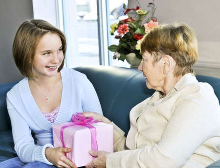 Granddaughter giving a present to her grandmother Stock Photo - 4440493