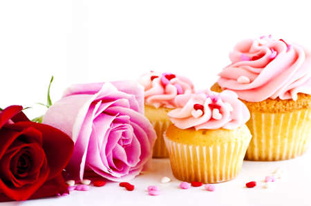 baked treat: Valentines day roses and cupcakes with pink icing