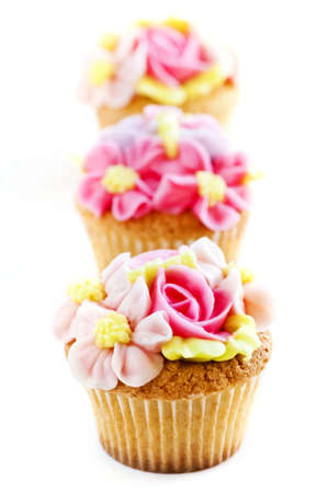 Row of tasty cupcakes with icing flowers Stock Photo - 4484542