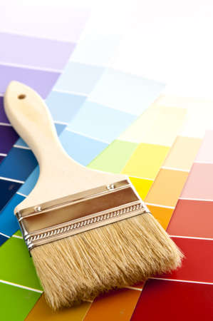 interior decorating: Clean paintbrush on rainbow of color card samples