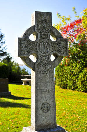 Bright graveyard lawn with ancient celtic crosses Stock Photo