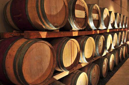 casks: Stacked oak wine barrels in winery cellar
