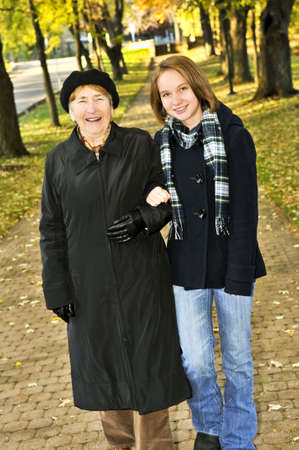 Teen granddaughter walking with grandmother in autumn park Stock Photo - 4687976