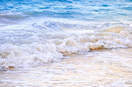 Tropical Caribbean sea waves breaking on the shore photo