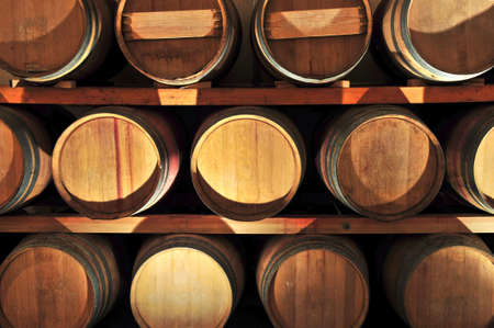 cask: Stacked oak wine barrels in winery cellar