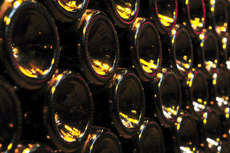 Large stack of wine bottle bottoms in winery Stock Photo