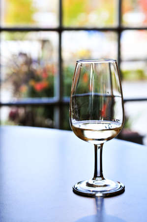 White wine glass in winery tasting event