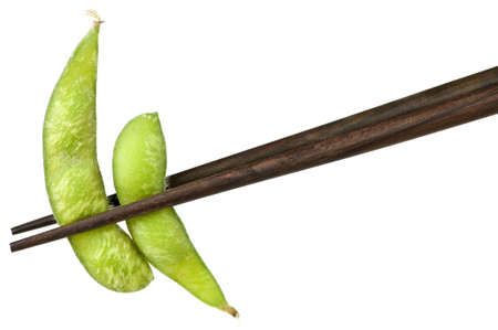 Edamame soy bean pods held by chopsticks