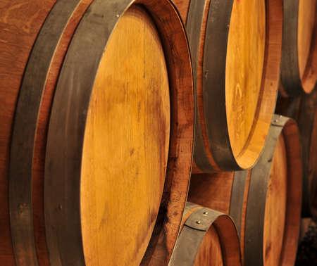 oak barrel: Stacked oak wine barrels in winery cellar