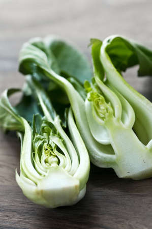 Close up of halved green bok choy vegetable greens