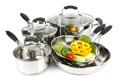 stainless: Stainless steel pots and pans isolated on white background with vegetables