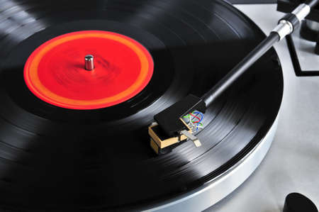 record: Vinyl record spinning on turntable close up