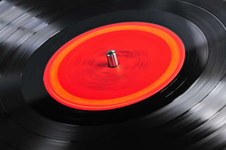 turning table: Vinyl record spinning on turntable close up