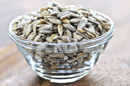 sunflower seeds: Shelled sunflower seeds close up in glass bowl Stock Photo