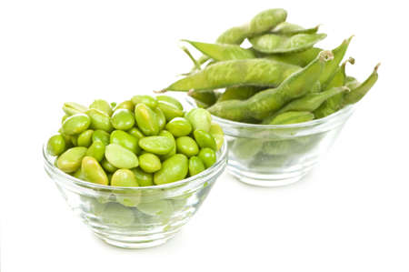 shelled: Edamame soy beans shelled and with pods in bowls