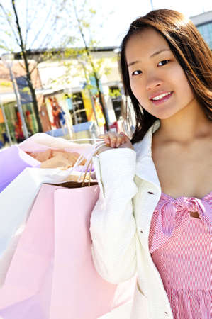 Young korean woman with shopping bags at outdoor mall Stock Photo - 4940192