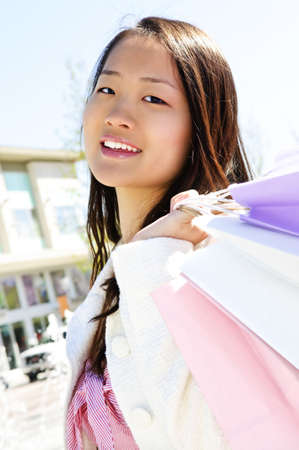 Young korean woman with shopping bags at outdoor mall Stock Photo - 4940193