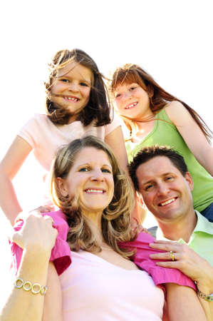 Portrait of happy family giving children shoulder rides
