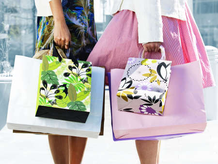 Two young girl friends holding shopping bags at mall Stock Photo - 4943824