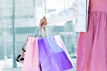 Young girl holding shopping bags at mall Stock Photo - 4943828