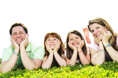 Portrait of happy family of four laying resting head on hands photo
