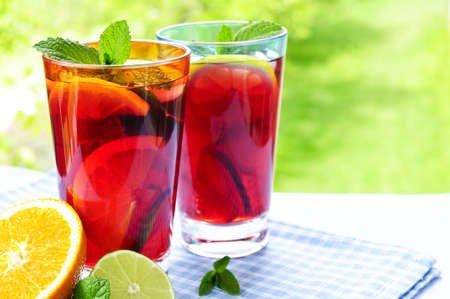 soft drinks: Refreshing fruit punch in two glasses outside Stock Photo