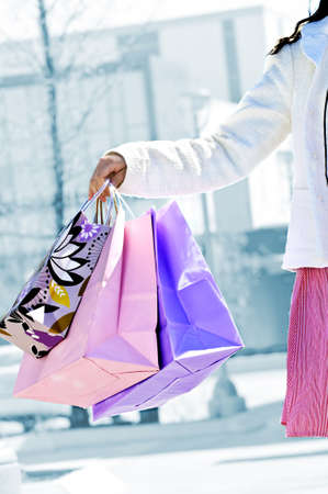 Young girl holding shopping bags at mall Stock Photo - 5010658