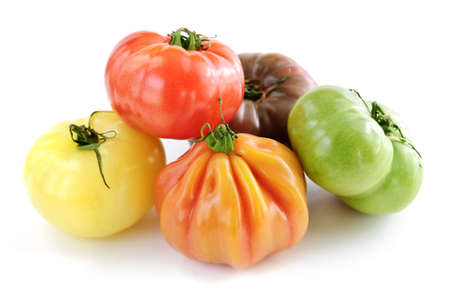 Multi colored heirloom tomatoes isolated on white background Stock Photo